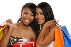 Beautiful African American Teens holding shopping bags