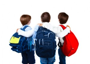 Three schoolboys isolated on white background