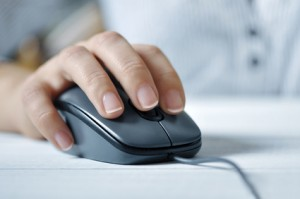 female hand with computer mouse