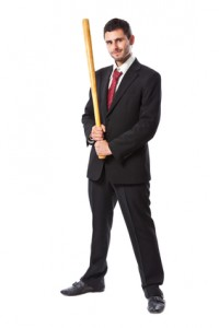 Businessman and baseball bat