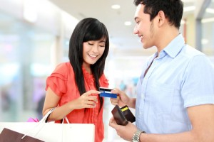 portrait of young man pay using credit card while shopping