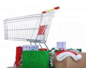 Shopping cart with boxes and bags, happy holidays