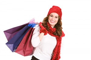 Cute woman dressed in wintery, holiday clothing, suitable for representing Christmas.