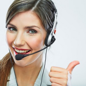 Customer support operator thumb show. call center smiling operator with phone headset.