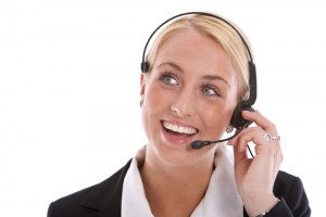 Pretty blond receptionist with radiant smile on the phone