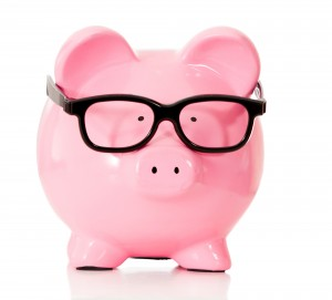 Geeky piggybank with glasses - isolated over a white background