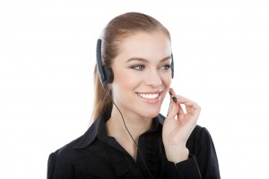 A portrait of a friendly customer serivce worker. Smiling caucasian woman answering a call.
