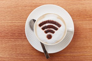 Free wifi area sign on a latte coffee in a bar