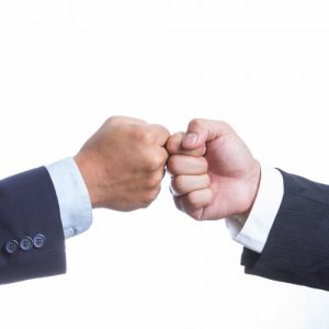 Two Businessman touching hand for coordination work